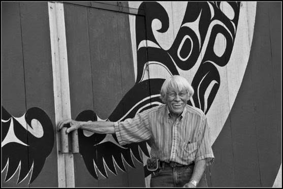 """Bill Holm at the doors to his """"Big House"""" John's Island. Photograph by Gregg Blomberg"""